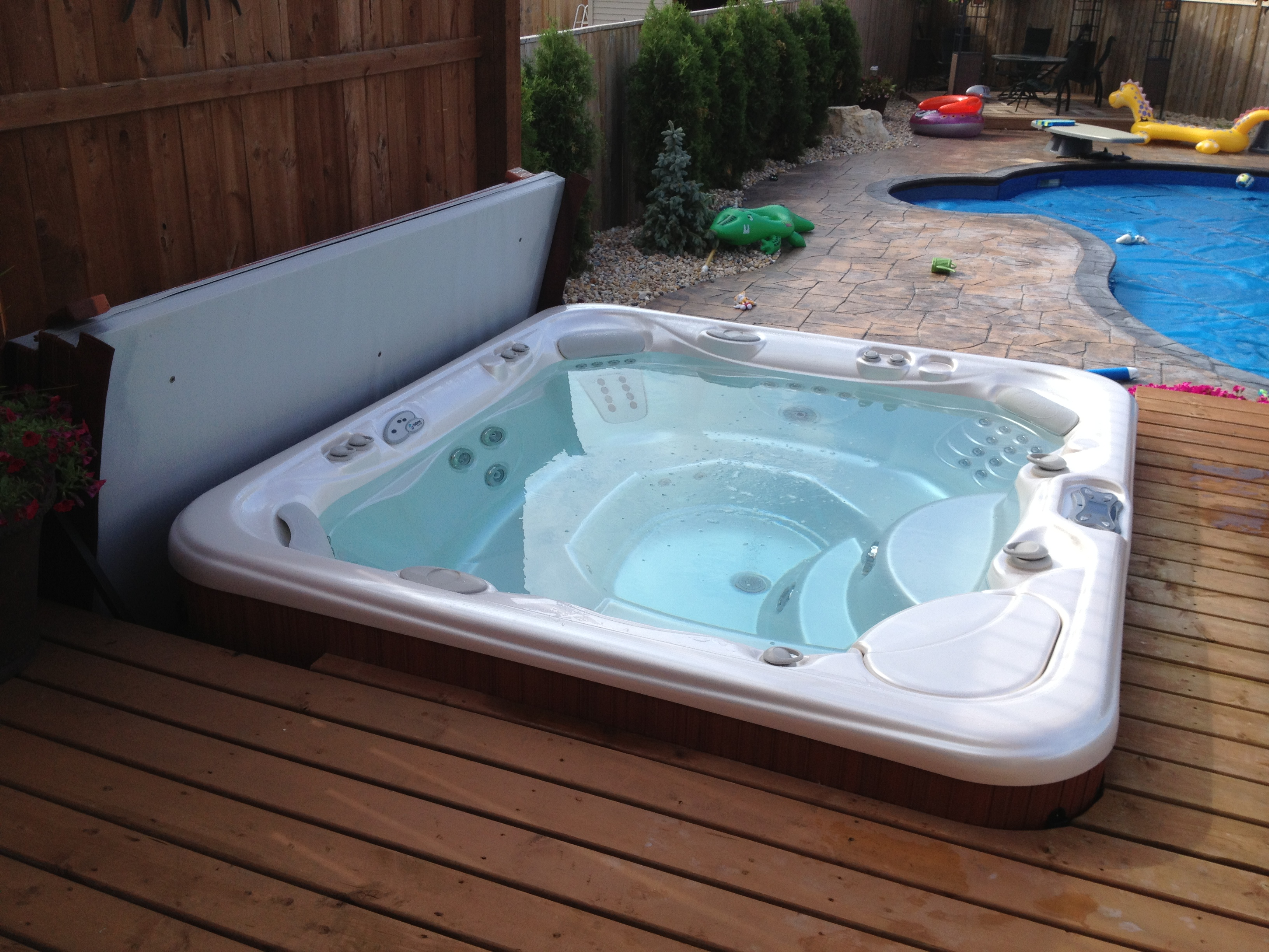 minneapolis pin round hot tubs rubadub springs northern great tub sunken roll cover covers pinterest indoor up wooden